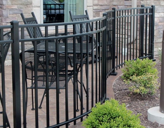 This is an aluminum fence with curved panels. It can be powder coated a variety of colors.