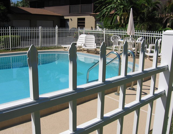 White aluminum fencing will not rust or corrode like wrought iron. It is the perfect fence for pools and planters. NOrwalk fence can install multiples styles and colors