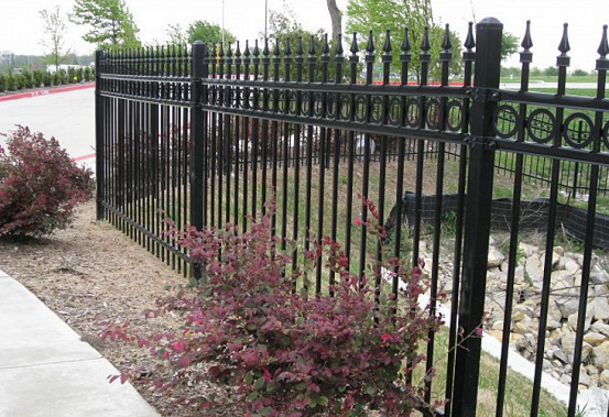 wrought iron system fences like this one are pre-manufactured and can be decorated with circles, spear tops, etc. They also come with extended warranties