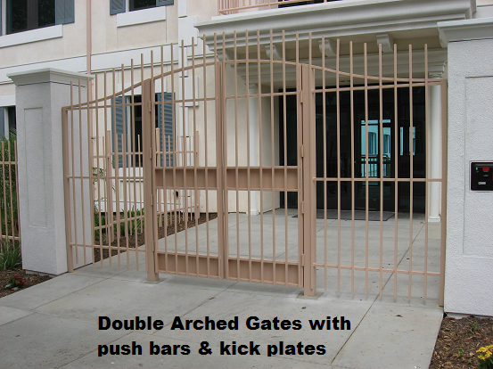 Swooped top gates in Downtown Los Angeles. The gates were built with panic bars and kick plates