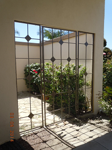 These custom iron gates were installed in Downey.  They were built to match an existing pattern.