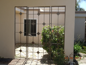 We can make custom gates such as this to match your house or business fence needs