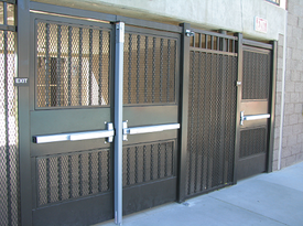 ADA gates such as these include kick plates and panic bars with outside lever locks
