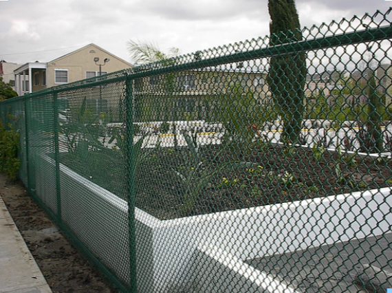Green vinyl chain link installed at a hotel in Los Angeles. Norwalk Fence also had the posts powder coated to match.