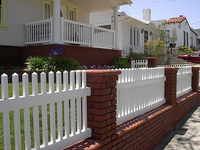 White picket vinyl fence was install close to the ocean. It will never rot or decay and this fence will never need painting.