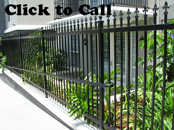 This wrought iron fence was manufactured with decorative finials and then powder coated black.
