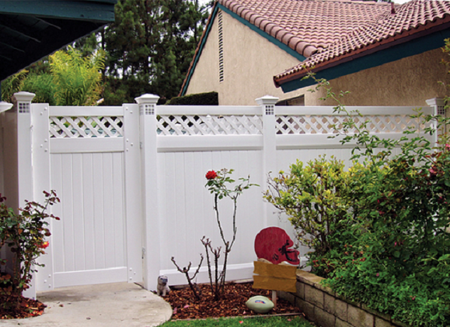 A beautiful white vinyl fence with lattice on top. Note the posts have light fixtures built into the fence posts