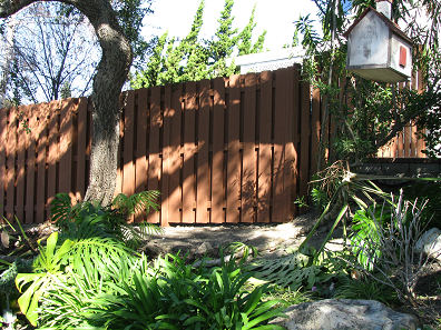Composite wood made from recycled materials in Whittier CA. This is a good neighbor fence design.