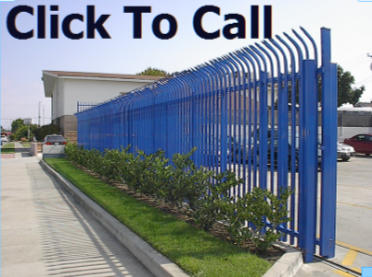 This is a blue curve top security wrought iron fence and rolling gate installed at a Honda Dealership.