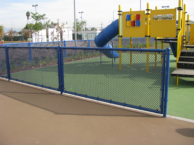 Blue vinyl coated chain link fence around a play ground at a school in Los Angeles CA. The pipe is powder coated to match.