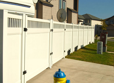 Privacy vinyl fencing with pickets on top' Vinyl gates match the fence creating a clean privacy fence