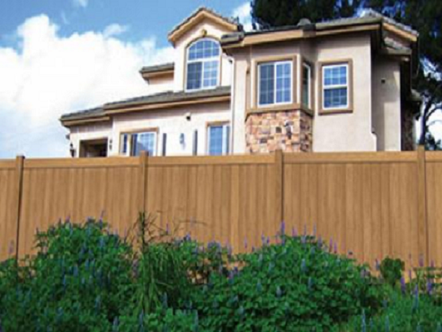 This is a wood grain vinyl fence. It is a perfect wood alternative that does not attract termites and will not dry rot